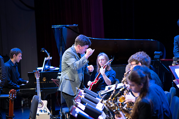 Conductor in front of a student jazz band