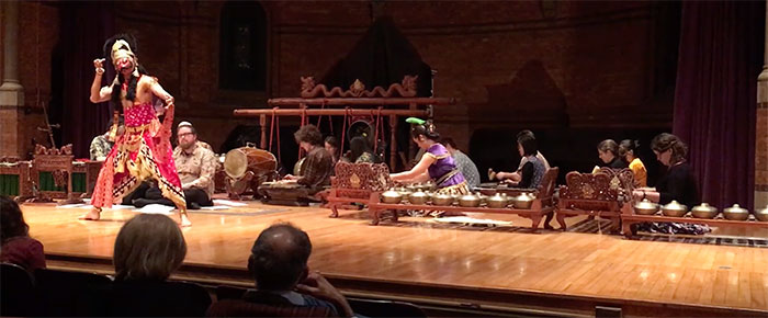 Gamelan performs with dancer onstage