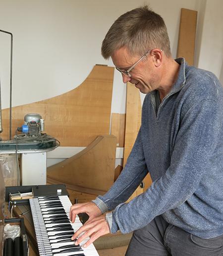 David Yearsley plays keyboard