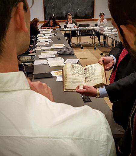 Students review a manuscript