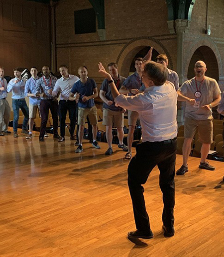 A man conducts a group of singers