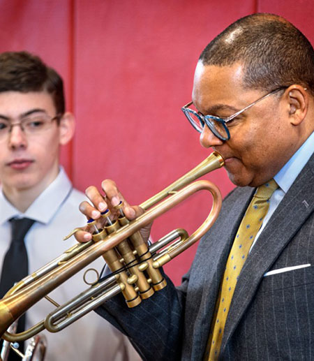 Wynton Marsalis and a young student