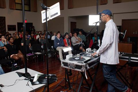 Presenter demonstrating turntables to audience