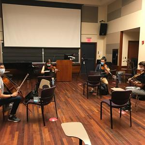 A string quartet rehearses with distancing and masks