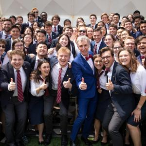 Chorus and Glee Club members with Bill Nye at 2019 Convocation