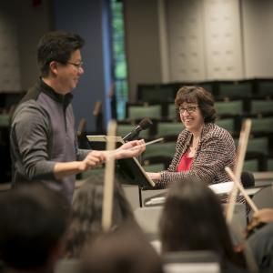 CSO conductor Chris Kim and Cornell President Martha Pollack