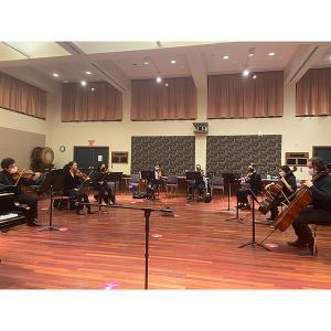 An octet rehearses with masks and distancing